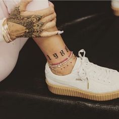 """Rihanna got """"1988,"""" the year she was born, tattooed on her ankle. Maybe she will follow in TSwift's footsteps and release an album called """"1988""""?! - Seventeen.com"""