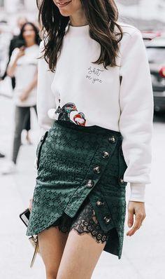 date night street style green miniskirt white sweatshirt