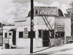 Walker Evans: I like this photo because I like the angle he captured the photo from and I like the old coca cola bill board in the photo.