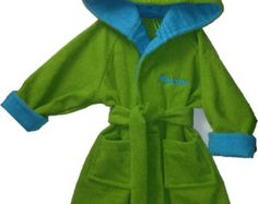 These adorable handmade  bathrobes are made from a 100% soft cotton terry cloth. The hood and cuffs are double lined with a contrasting trim. Robe has two patch pockets, and a detachable belt for easy washing. Available in a variety of bright bold color  combinations. Available in sizes 5-  child size 6X. Can be personalized ( no extra charge). With child's name in a matching thread. Great for bath, pool and beach. an ideal birthday  gift, or a perfect gift for the holidays.