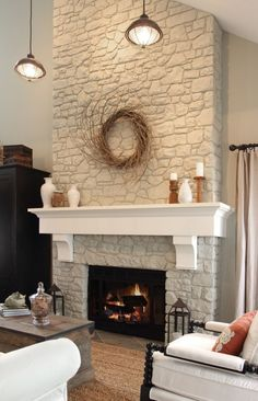 paint fireplace rock off-white. add reclaimed wood mantle or something like this. by tammie