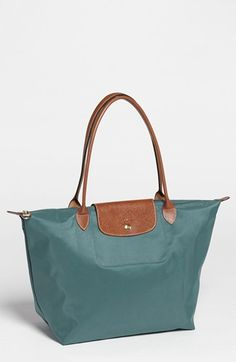 Free shipping and returns on Longchamp 'Large Le Pliage' Tote at Nordstrom.com. A customer-favorite, water-resistant nylon tote is offered in a range of colors, each trimmed with embossed leather for classic contrast. This version is a new, trimmed-down size with a shorter, more elegant strap drop.