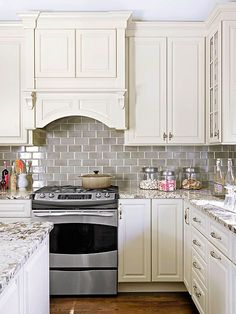 subway tile, warm white cabinets, wood floors