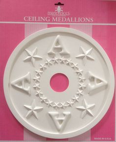 Ceiling medallion in star monogram design by Marie Ricci.