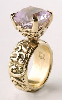 14k gold and pink kunzite Om ring  Hmmm I would lower the head a bit for a better look!