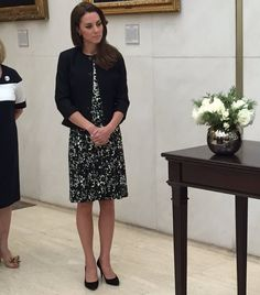 Prince WIlliam and Duchess Catherine at US Embassy to sign the Book of Condolences after the Orlando terrorist attack on nightclub in which 50 were killed and 50+ were injured.  Catherine is wearing a new Tory Burch dress.