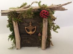 This is a handmade miniature magnetic Gnome or Fairy Door made out of reclaimed wood, antique brass door knocker, natural moss and magnet affixed to the back. Would look great in the garden or inside on your refrigerator or in a display!!! Each one is very unique and true conversation piece ! Great for weddings ! Check out my other list of Door items! H 3x 4