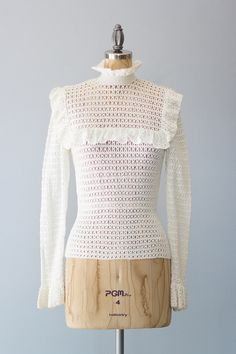 Vintage 1970s off white hand made crochet cotton sweater with pretty ruffle trim and buttons up the back.  ✂ ✂ ✂ M E A S U R E M E N T S ✂ ✂ ✂  fits