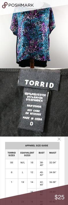 Torrid Blouse Torrid brand. Size 0 (please check picture for Torrid's website size chart). Multicolor front, plain black back. Hi-Lo style (the back is longer than the front) torrid Tops