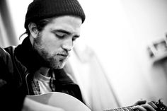 Robert Pattinson, i love seeing him with a guitar or on the piano :)-CJR