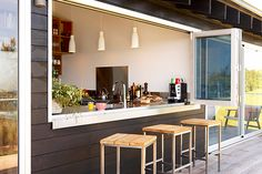 A modern beach house in Copacabana boasts a completely indoor-outdoor kitchen & dining set up. House, Modern Beach House, Kitchen Remodel, Kitchen Dining Sets, Kitchen Window Bar, New Kitchen, Home Kitchens, Indoor Outdoor Kitchen, Kitchen Design