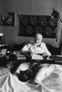 Henri Matisse in Bed Working, His Black Cat at His Feet, Nice, France , August 1949 photo by Robert Capa