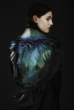Founded by Lauren Bowker, The Unseen studio is specialized in experimental research of textile materials. For this project named Air, the studio focused on natural iridescence and tamed its incredible changing colors palettes by applying it on an organic sculpture worn by a model