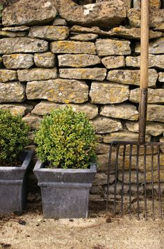 May- garden tools ?The Swenglish Home: Playful decorating Garden Gates, Garden Beds, Garden Tools, Boxwood Planters, Dry Stack Stone, May Garden, Brick And Stone, Stone Walls, Stone Work