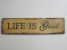 """Life Is Good: a 20"""" x 5"""" primitive sign on distressed wood. $15.00, via Etsy."""
