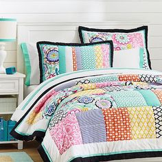 Colors and patterns are amazing in this bed set.....Patch It To Me Quilt + Sham #pbteen