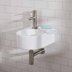 Complete a bath or powder room with the Lacefield Wall-Mount Sink. This sturdy bathroom sink is ideal for a small bathroom where space is at a premium. Made of porcelain, this sink will retain is glossy sheen over time, just as its fresh shape and compact Small Basement Bathroom, Wall Mounted Bathroom Sinks, Small Bathroom Vanities, Tiny Bathrooms, White Vanity Bathroom, Bathroom Ideas, Narrow Bathroom, Modern Bathrooms, Bathroom Fixtures