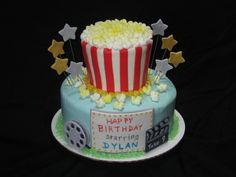 Outdoor movie themed cake complete with a cake version of a bucket of popcorn.