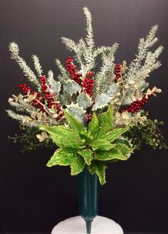 Faux Holiday Memorial Cone: Winter Mint Green wire poinsettia, frosted pine berry branches and gold glitter eucalyptus picks. Original design and arrangement by http://nfmdesign.synthasite.com/