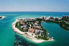 Sarasota FL. South end of Longboat Key behind the gates of the Longboat Key Club.  On the left is New Pass with the Gulf at the top of the pictures.