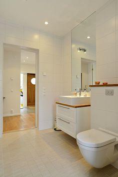 White and beige tiles, wood accents White Bathroom, Modern Bathroom, Bathroom Images, Bathroom Ideas, Small Bathroom Inspiration, Wood Accents, White Tiles, Humble Abode, Corner Bathtub