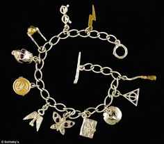 The 'Lumos Maxima' charm bracelet, designed in part by J K Rowling, is expected to reach £20,000 when it is auction next week