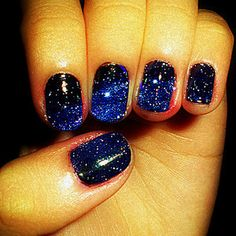 gorgeous galaxy nails... I like this better than the nebula nail trend
