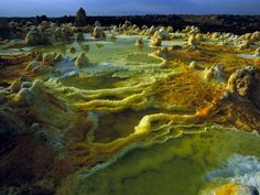Dallol Volcano, Ethiopia Photograph by Carsten Peter Sulfur, salt, and other minerals color the crater of Ethiopia's Dallol volcano.