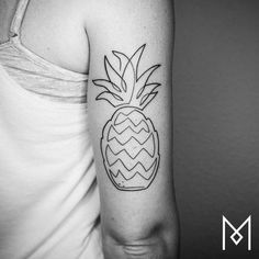 Continuous line pineapple tattoo on the back of the right arm....