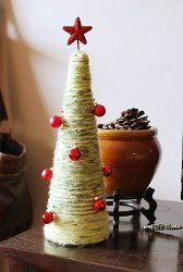DIY Yarn Wrapped Christmas Trees - tutorial by Pretty Ditty. These homemade Christmas decorations can be made with your favorite leftover yarns!