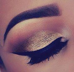 Cat eyes, make up.