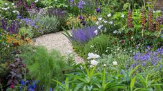 My kind of planting. The curved path continues through packed flower borders, with low foliage brushing at the visitors' ankles. Garden Borders, Garden Paths, Flower Borders, Garden Show, Dream Garden, Flower Garden Pictures, Chelsea Garden, Flower Garden Design, Chelsea Flower Show