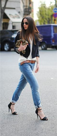 Belted boyfriend jeans paired with heels and blazer