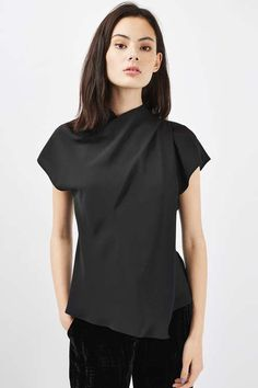 Master casual elegance in this high neck top, featuring classy drape neck detail and cap sleeves. In a chic all-black, it is perfect styled with wide leg trousers and colourful accessories. #Topshop