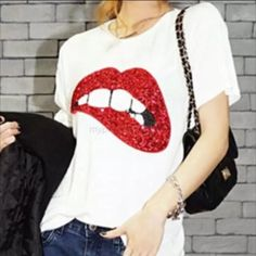 *More Sized Coming Soon!!* Red Sequin Lips T-Shirt Who says Tee's can't be fancy? This red glitter lip top is for all you fancy pants out there! Cotton blend. Boutique Tops Tees - Short Sleeve