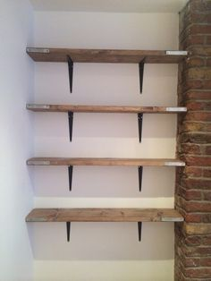 Scaffold Board Shelving. I recently brought some new scaffold Boards from B&Q cut them done to size and stained them with a ronseal wax. Very easy. Also purchased some £2. White L shape brackets (also B&Q) and sprayed them black. Total cost to complete approx £80