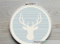 A beautiful modern deer silhouette pattern. Great to hang on your wall or as a pillow cover. Stitched on 14 count aida the design fits in a 10 inch