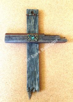 """The Old Rugged Cross"" is lovingly made from discarded wood and broken jewelry.  It is a reminder that Jesus died for our sins when we were discarded and broken.  Each piece of jewelry has been reclaimed and is ""fit for a KING"".    Approx. 15"" tall  and 11"" wide."
