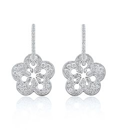 Signature Pave Blossom Earrings. A playful, elegant pair of drop earrings from Boodles' iconic Blossom collection, set with 1.02ct of round-brilliant cut diamonds in 18ct white gold with post and butterfly fastening.