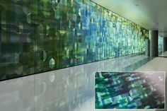 LEVELe Wall Cladding System with Blind panels; insets in ViviSpectra VEKTR glass with custom interlayer