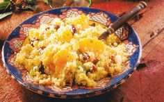 Olives, oregano, and orange combine to make a light, fresh dressing for delicate couscous.