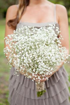 baby's breath! Beautiful AND not expensive. Plus, LOVE the color of the bridesmaids dress.