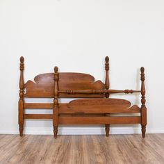 This full-sized headboard and footboard are featured in a solid wood with a cherry finish. Each bedframe has carved ball turning and fluted legs, a carved cresting rail, and pine finial tops. An elegant addition to any bedroom! #traditional #beds #headboard&footboard #sandiegovintage #vintagefurniture