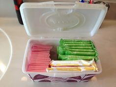organize feminine hygiene products in old wipes containers