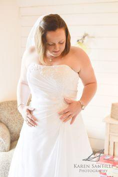 Bridal shots, bright lights, wedding photo, getting ready, putting on the dress