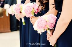 The girls carried pink, blush and white peony and green hydrangea bridesmaid bouquets by Bella Flowers.