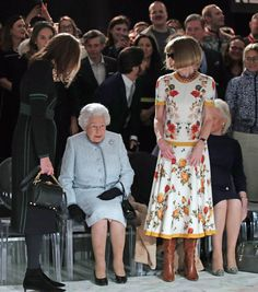 Queen Elizabeth II sits next to Anna Wintour and Caroline Rush, chief executive of the British Fashion Council (BFC) (L) as they view Richard Quinn's runway show before presenting him with the inaugural Queen Elizabeth II Award for British Design as she visits London Fashion Week's BFC Show Space on February 20, 2018 in London, United Kingdom