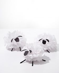 """Hosting a springtime baaaa-sh? Your guests won't be able to resist """"oohing"""" and """"awwing"""" over these fluffy sheep decorations, made easily with white tissue paper and cardstock."""