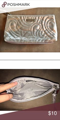 Silver Sephora Wristlet A silver, barely used Sephora Wristlet that can be used for makeup, pencils, money IDs, anything! Comes with the wrist strap! Sephora Bags Clutches & Wristlets