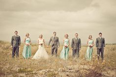 LOVE these colors. wowow going to go ahead and say this is one of my favorite BP pictures. Ah smaller bridal parties :)